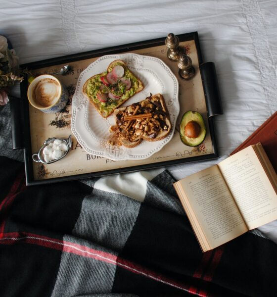 A vegan breakfast tray on a white cloth table